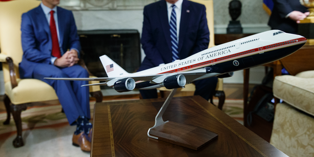 President Trump and Canadian Prime Minister Justin Trudeau meeting in the Oval Office this past June, behind a model of the new Air Force One design. (AP Photo/Evan Vucci, File)