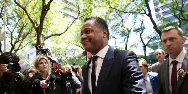 Actor Cuba Gooding Jr. arriving at the New York Police Department's Special Victim's Unit last week to face allegations he groped a woman at a city nightspot. (AP Photo/Mark Lennihan)