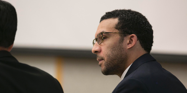 File - In this May 20, 2019, file photo, former NFL football player Kellen Winslow Jr. looks at attorney Marc Carlos during his rape trial in Vista, Calif. The former NFL star was convicted Monday, June 10, 2019, of raping 58-year-old homeless woman in San Diego County. (John Gibbins/The San Diego Union-Tribune via AP, Pool)