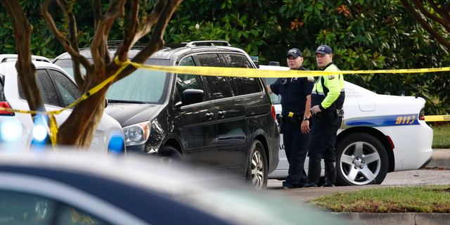Law enforcement officials work outside a municipal building that was the scene of a shooting, Saturday, June 1, 2019, in Virginia Beach, Va. A longtime city employee opened fire at the building Friday before police shot and killed him, authorities said. (AP Photo/Patrick Semansky)