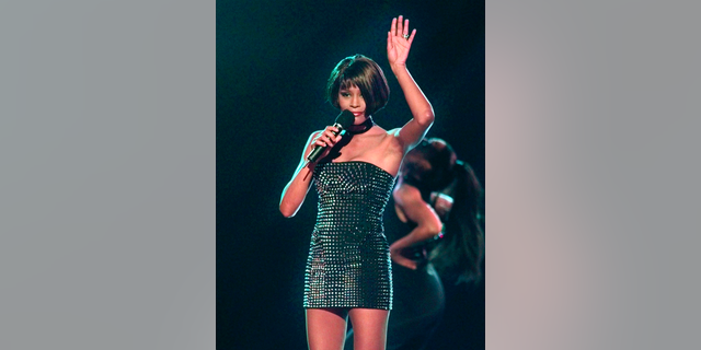 This March 26, 1999 file photo shows Whitney Houston performing at the 13th annual Soul Train Music Awards in Los Angeles, Calif.