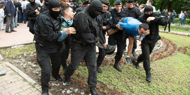 Kazakh police detain demonstrators during an anti-government protest during the presidential elections in Almaty, Kazakhstan, Sunday, June 9, 2019. Voters in Kazakhstan are choosing a successor to the president who had led the Central Asian country since independence from the Soviet Union, with a longtime loyalist expected to win easily. (AP Photo)