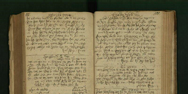 This undated photo provided by the Israel National Library, shows a document from Halberstadt, Germany, written in the 18th century. The library has begun digitizing communal ledgers of modern European Jewish communities, known as pinkasim. The documents, were used by European Jewish communities hundreds of years ago to keep track of financial transactions, political happenings, relations with non-Jewish government bodies, and even funny moments in the communities. (Israel National Library via AP)