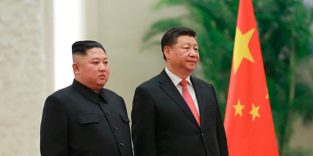 "FILE - In this Jan. 8, 2019, file photo provided by the North Korean government, North Korean leader Kim Jong Un, left, and Chinese President Xi Jinping attend a welcome ceremony at the Great Hall of the People in Beijing. Xi said North Korea is taking the ""right direction"" by politically resolving issues on the Korean Peninsula in a rare op-ed published by a North Korean state newspaper Wednesday, June 19, 2019, a day before Xi visits Pyongyang to meet Kim. (Korean Central News Agency/Korea News Service via AP, File)"