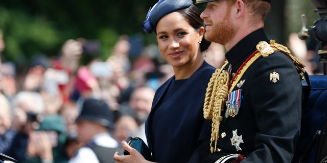 Meghan, a Duchess of Sussex and Prince Harry float in a carriage to attend a annual Trooping a Colour Ceremony on Jun 8, 2019, in London.  (AP Photo/Frank Augstein, file)