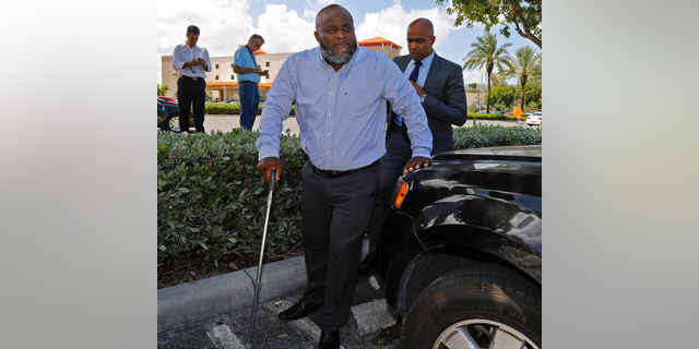 FILE - This July 28, 2016 file photo shows healthcare professional Charles Kinsey, who was shot by North Miami police Officer Jonathan Aledda  on July 18, 2016, while trying to protect an autistic patient, makes his first public appearance in Aventura, Fla. A jury deliberated for four hours late Monday, June 17, 2019,  before finding Aledda guilty of culpable negligence in the 2016 shooting of Kinsey. Aledda faces up to a year in jail but because he was acquitted of a felony, he might be able to remain a police officer.(Carl Juste/Miami Herald via AP, File)