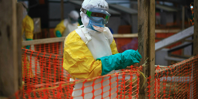 This Tuesday, April, 16, 2019 photo taken in Congo shows an Ebola health worker at a treatment center in Beni, Eastern Congo. Uganda's health ministry said late Tuesday, June 11, 2019 that a 5-year-old Congolese boy who crossed into Uganda has tested positive for Ebola in what is the first cross-border case of the deadly virus since an outbreak started in neighboring Congo last year. (AP Photo/Al-hadji Kudra Maliro, File)