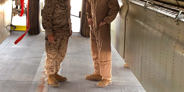 Marine Gen. Frank McKenzie, head of U.S. Central Command, confers with an Air Force officer below the bomb bay of a B-52 bomber on Friday, June 7, 2019 at al-Udeid air base in Qatar. (AP Photo/Robert Burns)