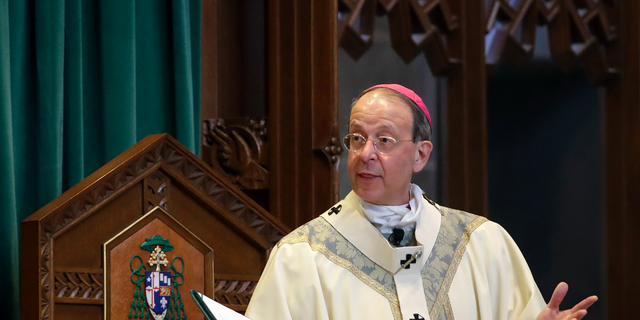 """FILE - In this March 28, 2017, file photo, Baltimore Archbishop William Lori leads a funeral Mass in Baltimore. On Wednesday, June 5, 2019, Lori released a report on an investigation into former Roman Catholic Bishop Michael Bransfield, in West Virginia, that found a """"consistent pattern"""" of sexual innuendo and suggestive comments and actions toward subordinates. (AP Photo/Patrick Semansky, File)"""