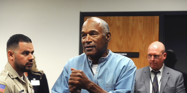 Former NFL football star O.J. Simpson reacts after learning he was granted parole at Lovelock Correctional Center in Lovelock, Nev.
