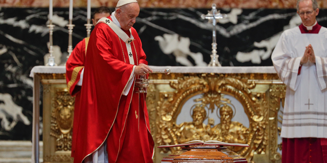 Pope Francis blesses the coffin as he celebrates the funeral service of Cardinal Leon Kalenga Badikebele, the Apostolic nuncio in Argentina, in St. Peter's Basilica at the Vatican, Saturday, June 15, 2019. (AP Photo/Gregorio Borgia)