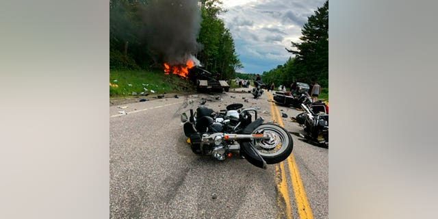 This photo provided by Miranda Thompson shows the scene where several motorcycles and a pickup truck collided on a rural, two-lane highway Friday, June 21, 2019 in Randolph, N.H. (Associated Press)