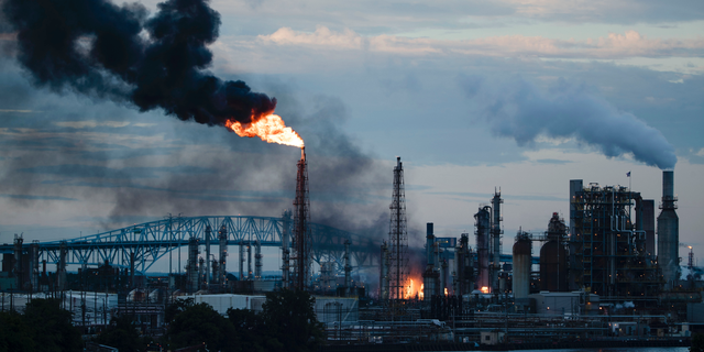 In this June 21 photo, flames and smoke emerge from the Philadelphia Energy Solutions Refining Complex in Philadelphia. (AP Photo/Matt Rourke, File)