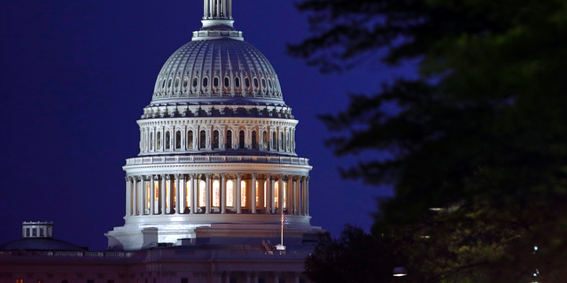 FILE - This April 18, 2019, file photo shows the dome of the U.S. Capitol in Washington. The Democratic-controlled House voted Tuesday, June 18, 2019, to block President Donald Trump's move to restrict transgender men and women from military service. (AP Photo/Patrick Semansky, File)
