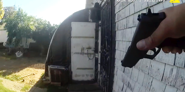 This still image taken from bodycam video released by the Sacramento Police Dept. shows the gunfight in which Sacramento Police Officer Tara O'Sullivan was shot (Sacramento Police Dept. via AP)