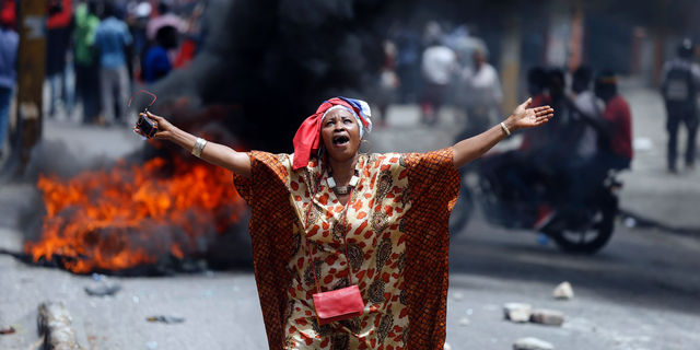 A protester yells anti-government slogans in Port-au-Prince, Haiti, Sunday, June 9, 2019. Protesters denouncing corruption paralyzed much of the capital as they demanded the removal of President Jovenel Moise. (AP Photo/Dieu Nalio Chery)