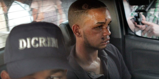 Eddy Vladimir Féliz Garcia, in custody in connection with the shooting of former Boston Red Sox slugger David Ortiz, is transferred by police to court in Santo Domingo, Dominican Republic, (AP Photo/Roberto Guzman)