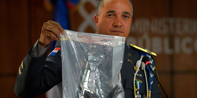 The director of the National Police, General Ney Aldrin Bautista Almonte shows the weapon that was used to shoot former Boston Red Sox slugger David Ortiz. (AP Photo / Roberto Guzman)