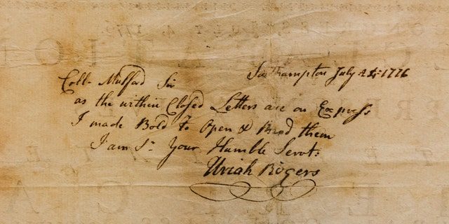 A handwritten note on the back of the printing of the Declaration of Independence. (Museum of the American Revolution)