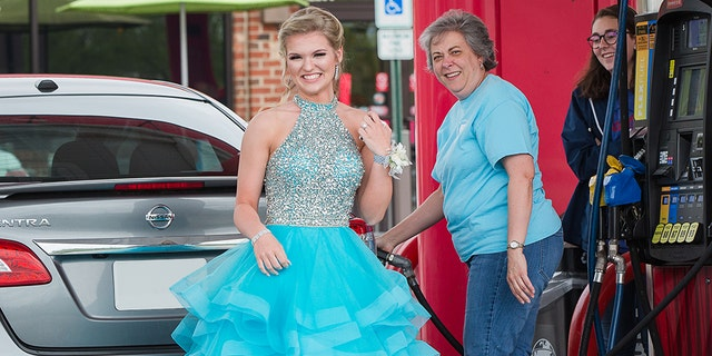 Devin Bennett and Sherry Allgood, pictured, met at the gas station of a Winston-Salem area Sheetz before the teen went off to the big dance.