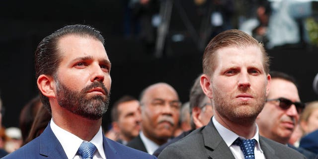 Donald Trump Jr., left, and Eric Trump attend a ceremony to mark the 75th anniversary of D-Day at the Normandy American Cemetery in Colleville-sur-Mer, Normandy, France, Thursday, June 6, 2019. (Ian Langsdon/POOL via AP)