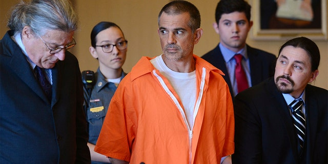 Fotis Dulos and his legal team including Norm Pattis, left, stand during a hearing at Stamford Superior Court. Fotis Dulos, and his girlfriend, Michelle Troconis, have been charged with evidence tampering and hindering prosecution in the disappearance of his wife, Jennifer Dulos. The mother of five has has been missing since May 24.