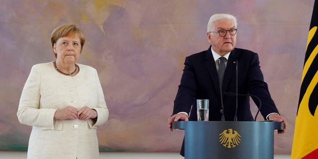 Angela Merkel was seen shaking at a public event for the second time in less than two weeks as she stood alongside President Frank-Walter Steinmeier at a ceremony in Berlin.