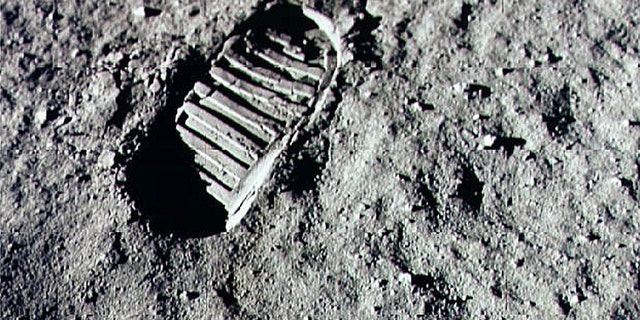 File print - a footprint from a Apollo 11 goal on a lunar surface.
