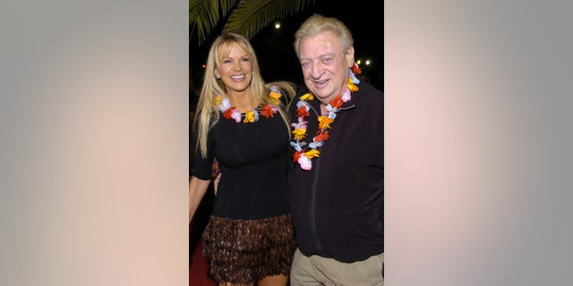 """Rodney Dangerfield and wife Joan Child during """"50 First Dates"""" premiere in Westwood, California. (Photo by L. Cohen/WireImage)"""