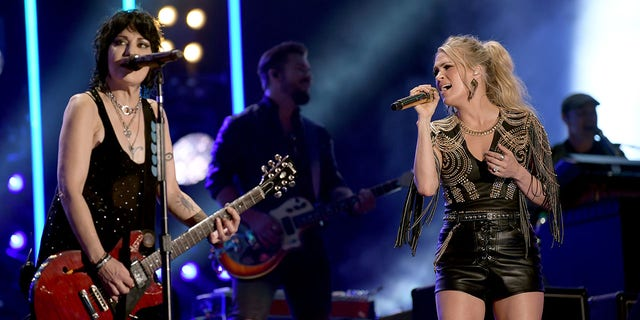 Joan Jett, left, and Carrie Underwood perform during day 2 of the 2019 CMA Music Festival on June 7, 2019, in Nashville, Tenn. (Getty Images)