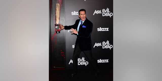 "Actor Bruce Campbell poses on arrival for the Los Angeles premiere of ""Ash vs Evil Dead"" in Hollywood, Calif., on Oct. 28, 2015."