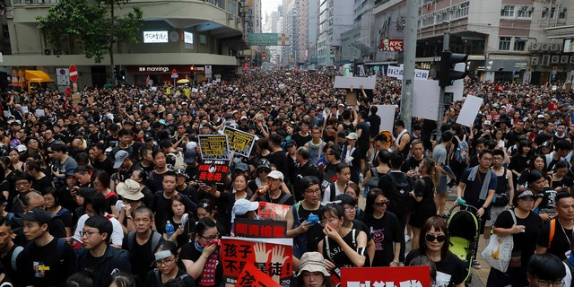 Tens of thousands of protesters march through the streets while protesting against extradition laws on Sunday, June 16, 2019, in Hong Kong.