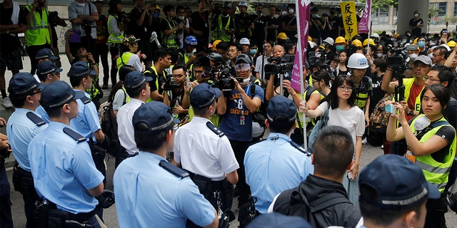 Protesters negotiating with police outside the Legislative Council building in Hong Kong.
