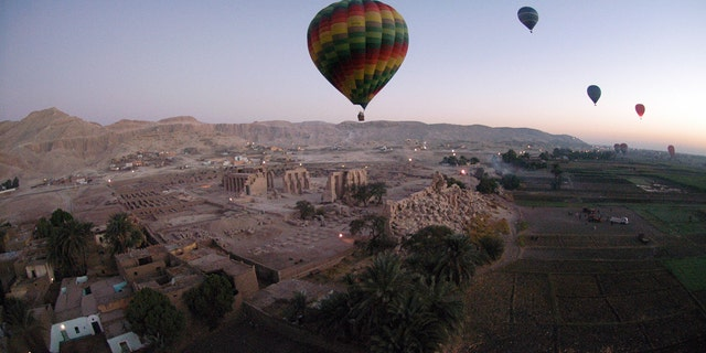 Nearly 360 tourists partake in hot air balloon tours over the city of Luxor and its surrounding area, as seen here in a 2007 photo.