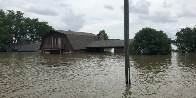 Historic flooding in Arkansas left neighborhoods inundated.
