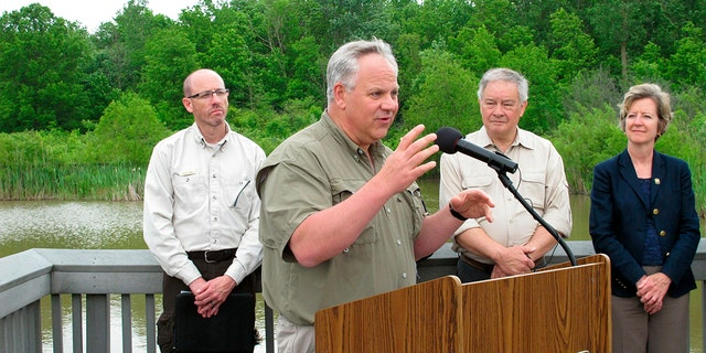 Interior Secretary David Bernhardt announces plans to expand hunting and fishing access in the nation's wildlife refuges, Wednesday, June 5, 2019, in Oak Harbor, Ohio. The plan affects 1.4 million acres on federal public lands.