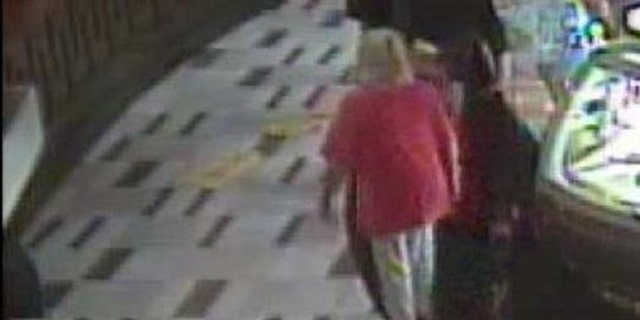 Ohio woman who slipped on collapsed 'wet floor' sign at