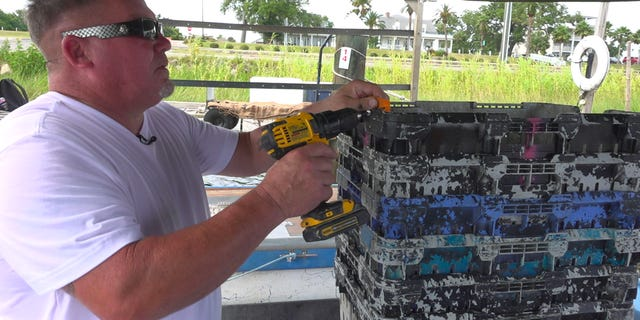 Commercial fishermen, Kevin Black labels his crab baskets during a tough season in the Mississippi Gulf coast. (Fox News/ Charles Watson)