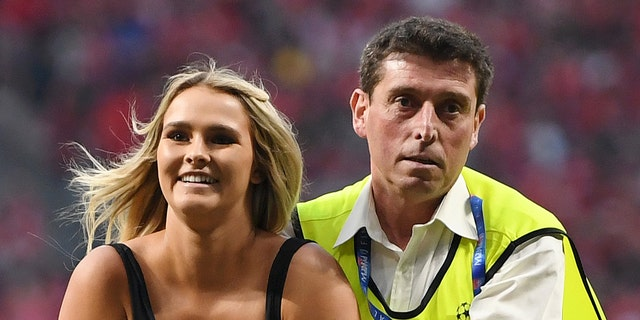 Kinsey Wolanski invaded the pitch and was taken away by security during the Champions League final soccer match between Tottenham Hotspur and Liverpool. (Photo by Matthias Hangst/Getty Images)