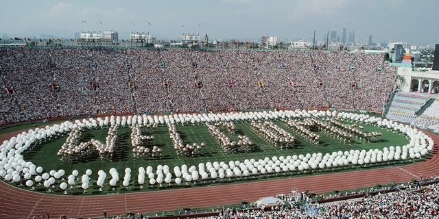 Performers spell out Welcome on the stadium infield during the opening ceremony for the XXIII Olympic Games on 28 July 1984 at the Los Angeles Memorial Coliseum in Los Angeles, California, United States. (Photo by Steve Powell/Allsport//Getty Images)