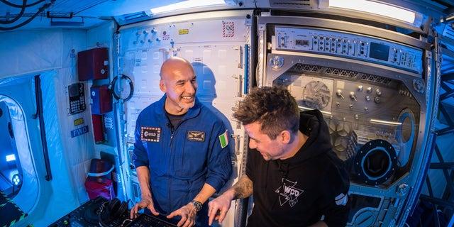German DJ Le Shuuk (right) teaching Space Station Commander Luca Parmitano (ESA astronaut) (left) how to DJ inside the Columbus Module at the ESA. (Courtesy of BigCityBeats)