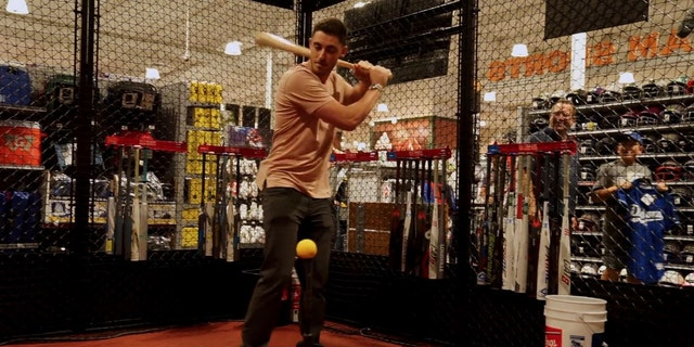 Cody Bellinger takes a few swings in the cage at DICK'S Sporting Goods in Tustin, Calif.