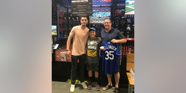 He had a meet and greet with the coach and his son, a hitting lesson and tickets to the Dodgers' Father's Day game against the Cubs