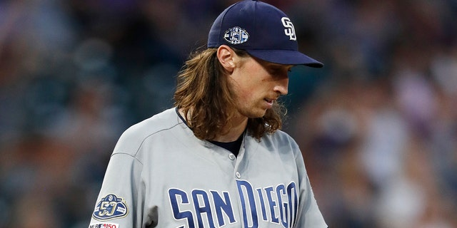 Matt Strahm was ejected from the game against the Colorado Rockies on Saturday. (AP Photo/David Zalubowski)