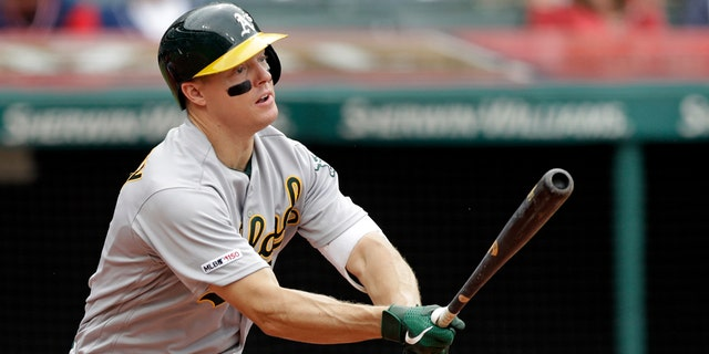 FILE - In this May 22, 2019, file photo, Oakland Athletics' Nick Hundley watches his ball after hitting a one-run double off Cleveland Indians relief pitcher Tyler Clippard in the seventh inning of a baseball game in Cleveland. Five years ago, Hundley visited Children's Hospital of Wisconsin and met a young man named Zach who sure needed a lift as he fought his battle with leukemia. (AP Photo/Tony Dejak, File)
