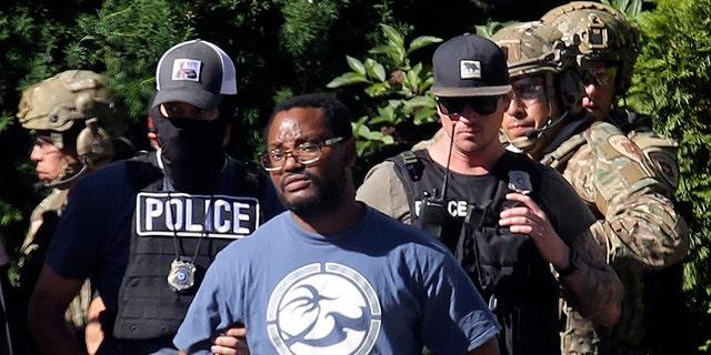 Salt Lake City police arrestedAyoola Ajayion Friday. (AP/The Deseret News)