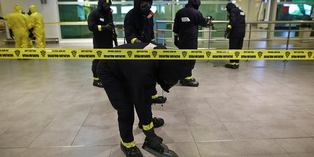 A Hazmat team conducting checks inside Kuala Lumpur International Airport after the killing of Kim Jong Nam in 2017. (Mat Zain/NurPhoto via Getty Images)