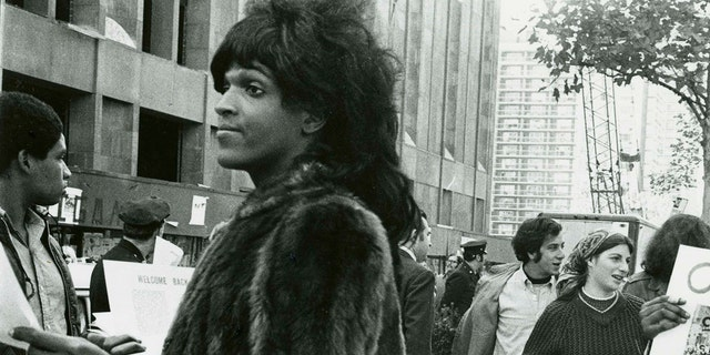 Transgender activist Marsha P. Johnson handing out flyers in support of Gay Students at NYU in 1970. (REUTERS/Diana Davies)