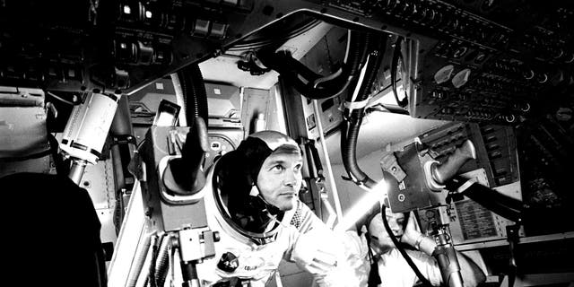 File photo - Photograph of the pilot Michael Collins at Apollo 11 Command Module, practicing docking hatch removal from CM simulator at NASA Johnson Space Center, Houston, Texas, June 28, 1969. Image courtesy National Aeronautics and Space Administration (NASA).