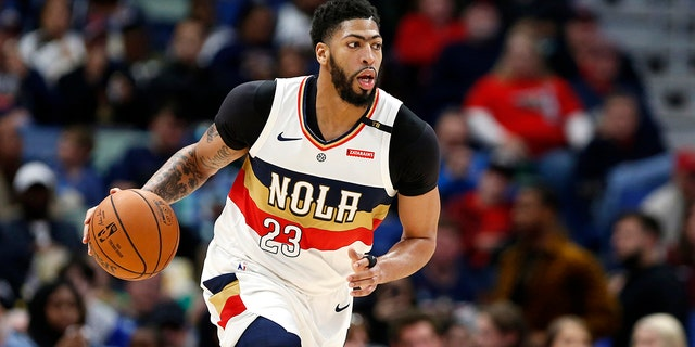 Two people familiar with the situation say the Pelicans have agreed to trade Davis to the Los Angeles Lakers for point guard Lonzo Ball, forward Brandon Ingram, shooting guard Josh Hart and three first-round draft choices. (AP Photo/Tyler Kaufman, File)